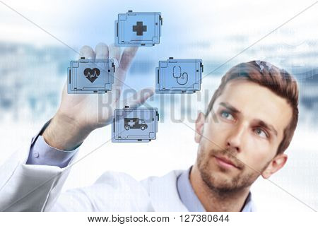 Doctor with medicine icons on virtual screen. Medical technology concept
