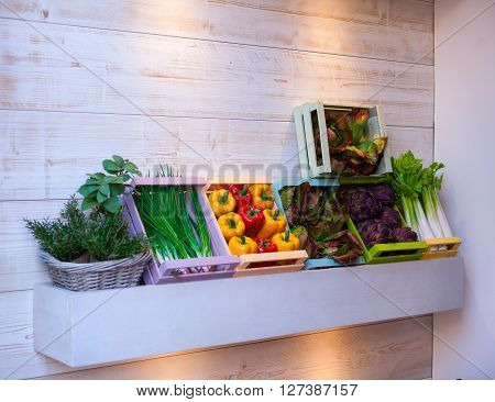 View of various vegetables inside the wooden boxes