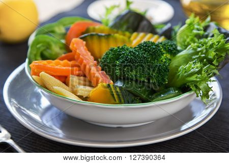 Pumpkin,Broccoli with carrot and baby corn salad in a bowl