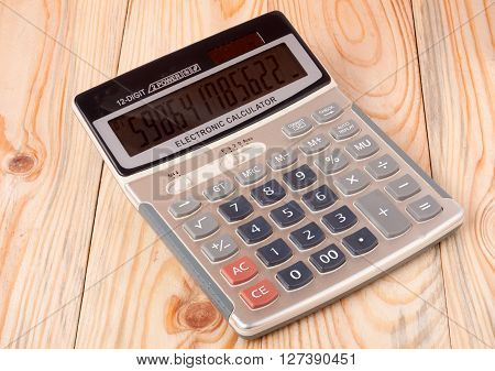calculator close up isolated on a light wooden background.