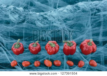 Tomato and sweet peppers beautifully lie on pure ice. One of the most beautiful glacial lakes on earth - Lake Baikal.