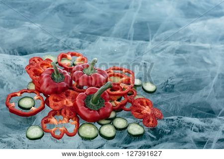 Sweet Peppers And Cucumber On Ice.