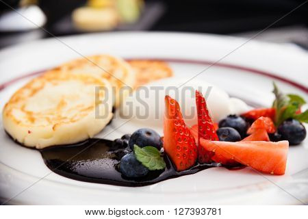 Syrniki with blueberry jam and buttermilk ice cream