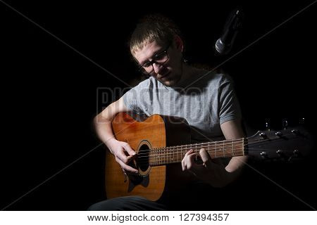 Musician Playing On Acoustic Guitar