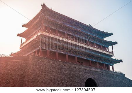 Beijing, China at the Zhengyangmen Gatehouse in Tiananmen Square. Beautiful historical building at sunset.