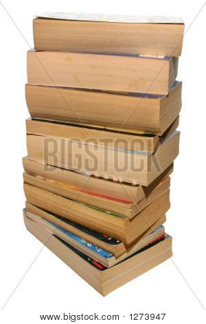 A Stack Of Old Paperback Books, Isolated On A White Background