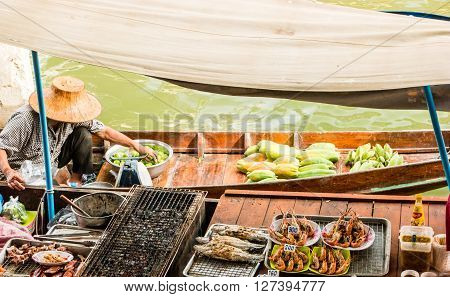 Seafood on trader's boats in a floating market in Thailand. Floating markets are one of the main cultural tourist destinations in Asia.