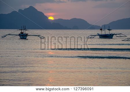 bancas boats on sunset in el nido palawan philippines