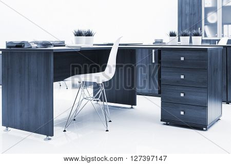 desk, plastic chair and bookcase on a white wall