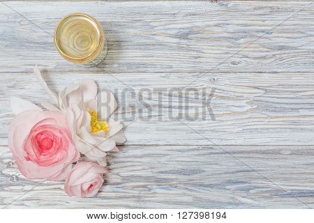 glass of white wine and flowers flat lay