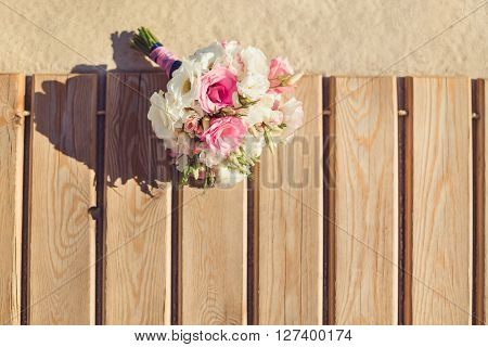 Bride's Pink and White Bouquet Laying on Pier. Wedding in Tropical Country Idea