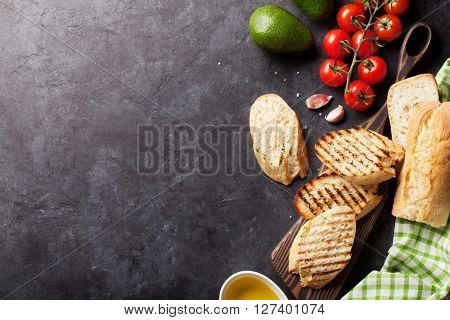 Ciabatta sandwich cooking over stone background. Top view with copy space