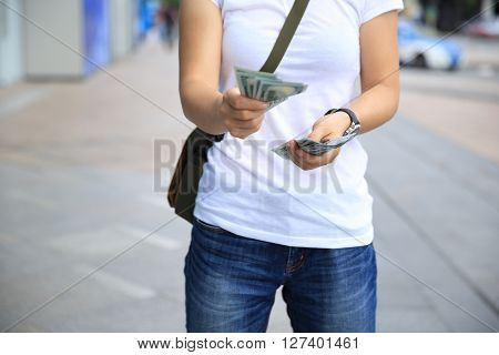 asian woman hands taking usd cash out from wallet