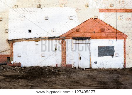 Traces of the demolished house on a brick wall