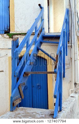 An old wooden blue staircase of color without walking.