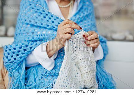 Mature woman knitting