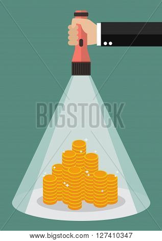 Hand holding flashlight glow to the money. Search in business