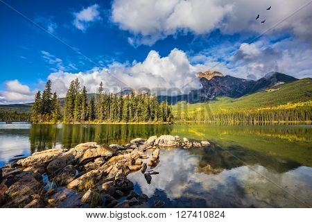 Transparent autumn morning in Jasper National Park, Canada. The woody small island in Pyramid Lake