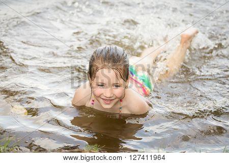 Pretty Nice Little Girl Swimming In Lake