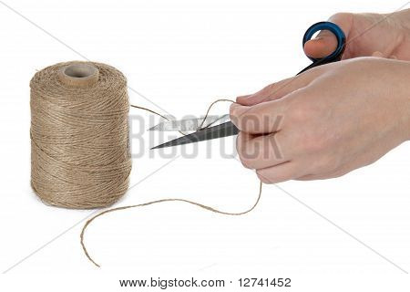 The Image Of A Hand With The Scissors Cutting A Rope, Isolated, On A White Background