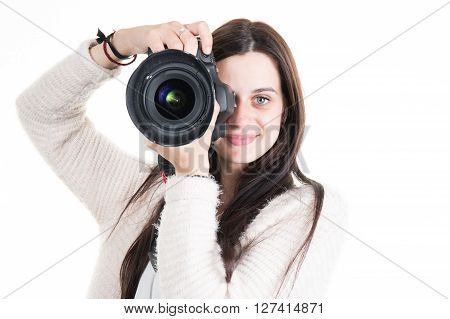 Young And Smiling Female Photographer Shooting You
