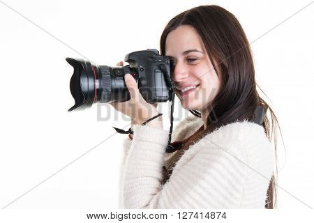 Profile View Of Female Photographer Shooting Someone In Studio