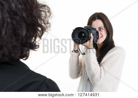 Female Photographer Shooting A Woman In Studio
