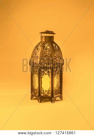 A colorful graphic design of a ramadan lantern. 'Ramadan Kareem' - A  graphic greeting card cover.