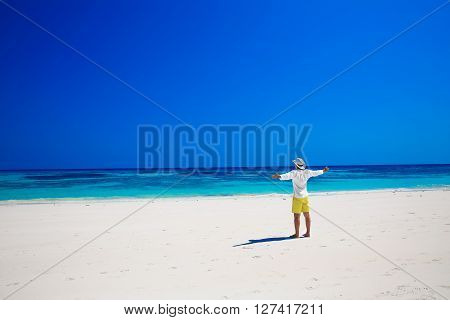 Nature. Seashore. Happy Free Man Raising His Hands Or Open Arms Enjoying Life On Tropical Freedom Be