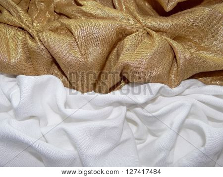 gold and white cloth laid in the crease, close up