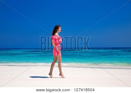Beautiful Slim Woman In Red Dress Enjoying On Exotic Sea, Tropical Beach. Summer Outdoor Portrait. A