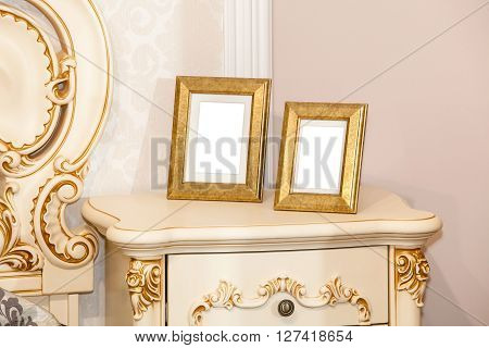 Two blank photo frame on the chest of drawers. Mock up of blank photo frame