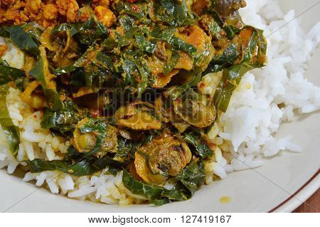 cockle curry with betel leaves on rice