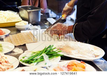 Preparing Of Traditional Japanese Sushi, Cutting