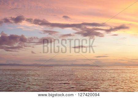 beautiful colorful sunset on the sea in the tropics