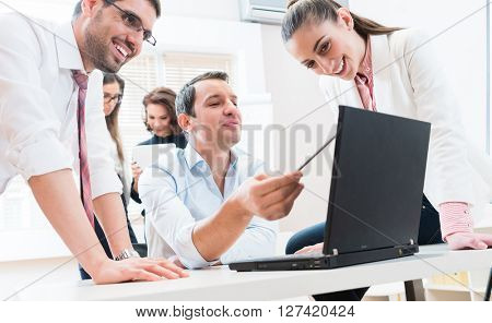 Business team reporting to boss having meeting in office