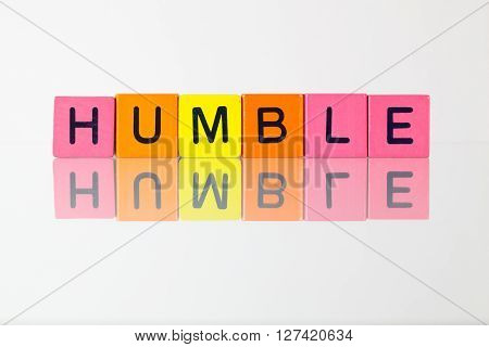 Humble - an inscription from children's wooden blocks
