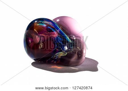 Hand made blue and pink glass bead on white background