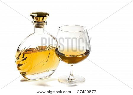 Bottle and a snifter of brandy on a white background