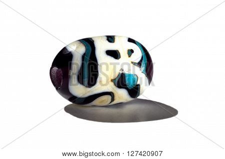Hand made blue and white glass bead on white background
