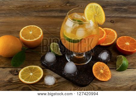Fresh citrus drink on wooden background. Fruit cocktail. Fruit drink. Fruit lemonade. Summer drink Citrus lemonade