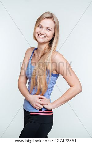 Smiling sports woman looking at camera isolated on a white background