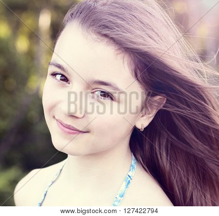 Beautiful natural beauty a little girl schoolgirl student in a dress, a summer bright sunny day outdoors fresh air idea concept fashion style happy smiles