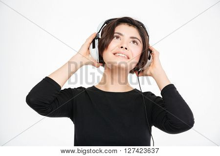 Happy woman listening music in headphones isolated on a white background