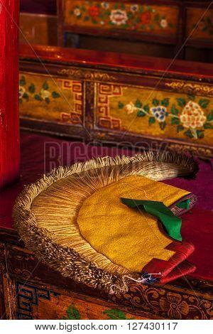 Yellow hat (attribute of  Gelug sect of Buddhism) in Likir Gompa (Tibetan Buddhist monastery). Ladakh, India