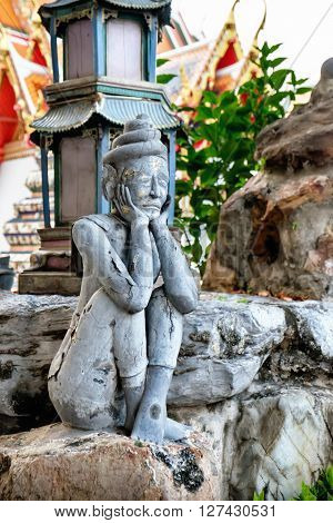 Detailed statue and architecture in Wat Pho Buddhist temple Bangkok Thailand. Wat Pho known also as the Temple of the Reclining Buddha. ** Note: Shallow depth of field