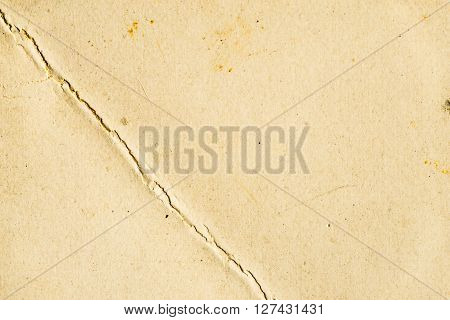 Old paper background with crack rugged, texture