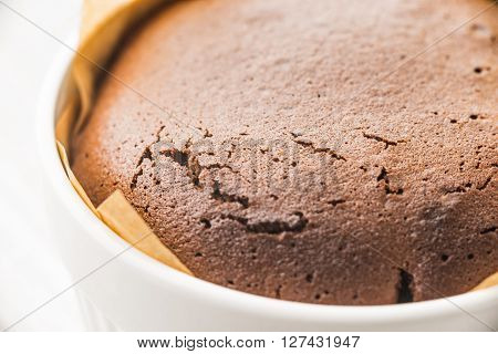 Chocolate fondant in the ramekin close-up horizontal