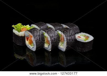 Japanese Cuisine. Sushi Roll Over Black Background.