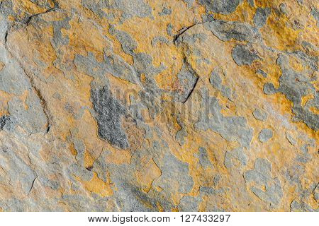 Colorful rugged stone background light, relief texture